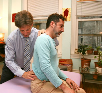 seated lumbar palpation